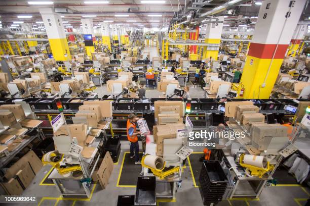 Workers prepare orders for shipment at the Amazoncom Inc fulfillment center in Passo Corese Rieti Italy on Thursday July 26 2018 Amazon reported a...