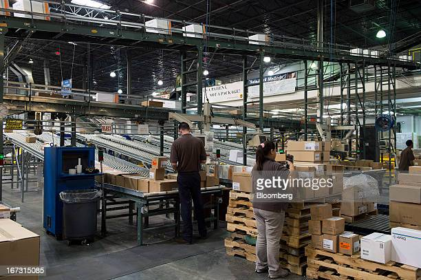 Workers prepare orders to be loaded for shipment at a United Parcel Service Inc Healthcare Supply Chain and Distribution Center in Atlanta Georgia US...