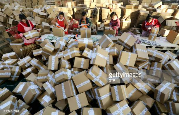 Workers prepare packages for delivery at a sorting center in Lianyungang Jiangsu province during the Singles Day online shopping festival on November...