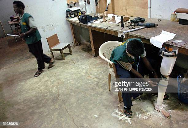 Workers prepare prosthesis limbs in their workshop in Kilinochchi an area controlled by the Tamil Tigers in northern Sri Lanka 12 January 2005 The...