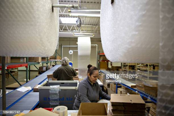 Workers prepare shipments in the directtoconsumer packaging area at the Primex Family of Cos facility in Lake Geneva Wisconsin US on Tuesday Jan 29...