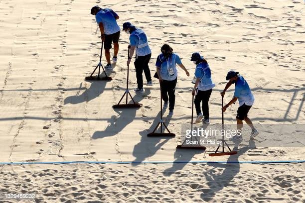 Workers prepare the Beach Volleyball court prior to a training session at Shiokaze Park on July 19, 2021 in Tokyo, Japan.