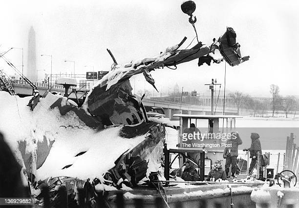 FILE Workers prepare the center fuselage of the 737 Air Florida Flight 90 from a barge on the Potomac River on January 21 1982 in Washington DC The...