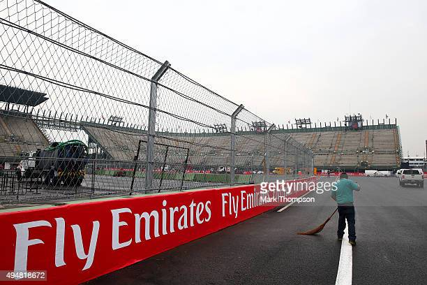 Workers prepare the circuit ahead of the Formula One Grand Prix of Mexico at Autodromo Hermanos Rodriguez on October 28, 2015 in Mexico City, Mexico.