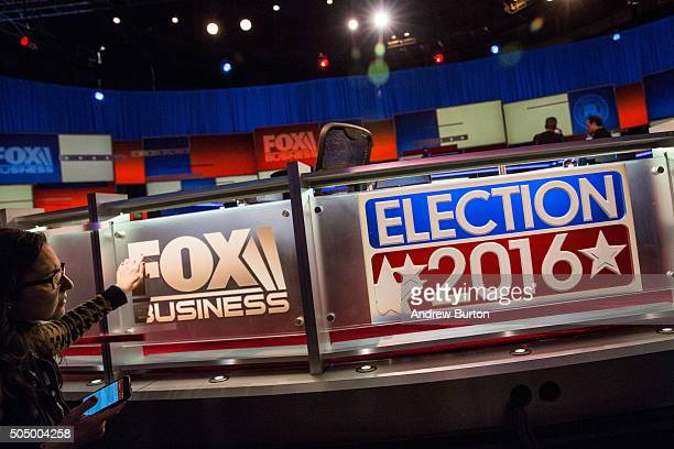 Workers prepare the debate hall for the Fox Business Network Republican presidential debate at the North Charleston Coliseum and Performing Arts...