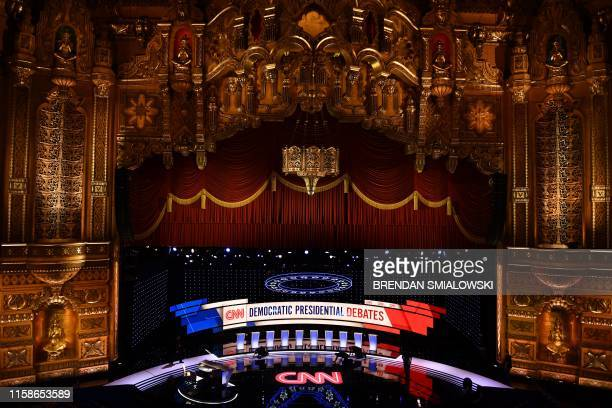 Workers prepare the debate stage at the Fox Theater in Detroit, Michigan, on July 30 ahead of the 2nd Democratic Presidential Debate. - Leading...