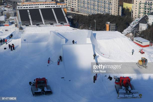Workers prepare the extreme skiiing courses ahead of the PyeongChang 2018 Winter Olympic Games at Phoenix Park on February 6 2018 in Pyeongchanggun...