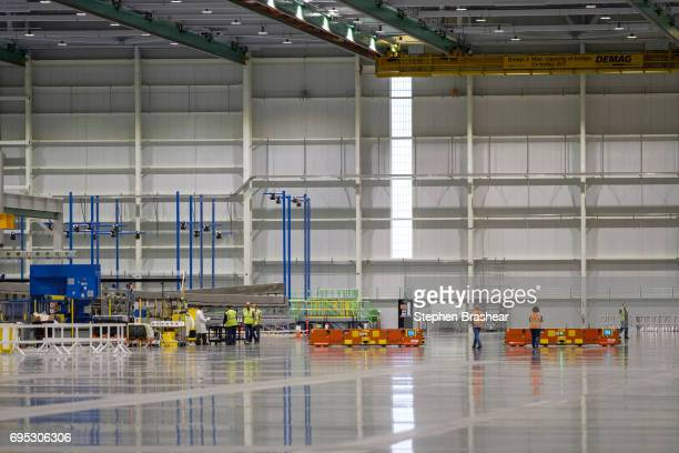 Workers prepare the facility for production of the Boeing 777X at the Composite Wing Center on June 12 2017 in Everett Washington The production of...