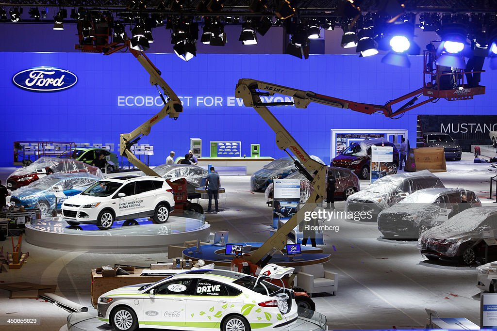 Workers prepare the Ford Motor Co. hall before the opening of the LA Auto Show in Los Angeles, California, U.S., on Tuesday, Nov. 19, 2013. The 2013 LA Auto Show is open to the public Nov. 22 - Dec. 1. Photographer: Patrick T. Fallon/Bloomberg via Getty Images