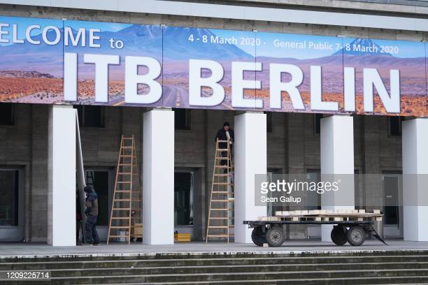 Workers prepare the main entrance of the Messe Berlin trade fair halls ahead of the upcoming ITB tourism trade fair on February 28 2020 in Berlin...