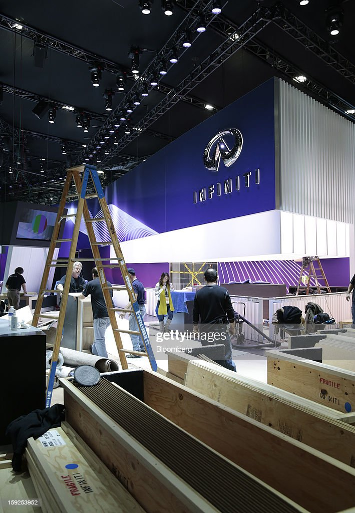 Workers prepare the Nissan Infiniti Inc. exhibit during an advance tour of the North American International Auto Show (NAIAS) at Cobo Hall in Detroit, Michigan, U.S., on Thursday, Jan. 10, 2013. More than 23,000 attendees representing almost 2,000 companies are expected to attend the industry preview for NAIAS on Jan. 16-17. The general public can attend the show from Jan. 19-27. Photographer: Jeff Kowalsky/Bloomberg via Getty Images
