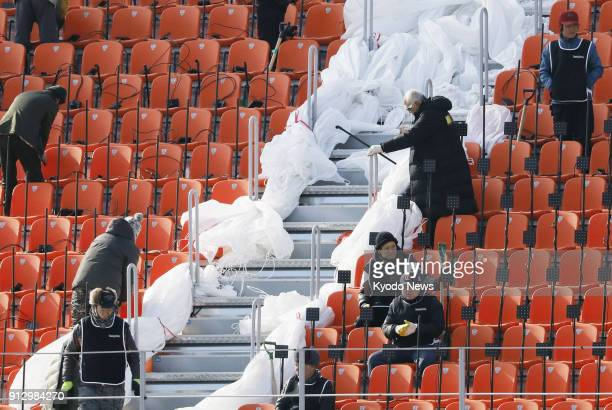 Workers prepare the Olympic Stadium in Pyeongchang South Korea on Jan 28 for the start of the Winter Games ==Kyodo