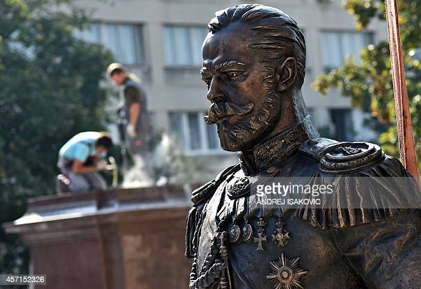 Workers prepare the plinth where the monument of the last Russian Emperor Tsar Nicholas II will be placed in Belgrade on October 13 2014 According to...