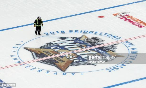 Workers prepare the rink prior to the 2018 Bridestone NHL Winter Classic which will occur on New Years' Day at Citi Field on December 29 2017 in the...