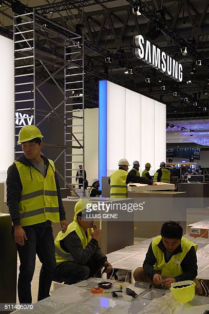 Workers prepare the Samsung stand facilities for the Mobile World Congress in Barcelona on February 20 before the start of the world's biggest mobile...