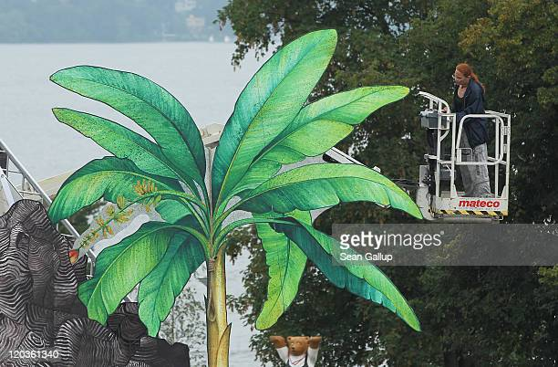 Workers prepare the set for the Seefestspiele 2011 music festival ahead of the performance of Mozart's The Magic Flute at Strandbad Wannsee on August...