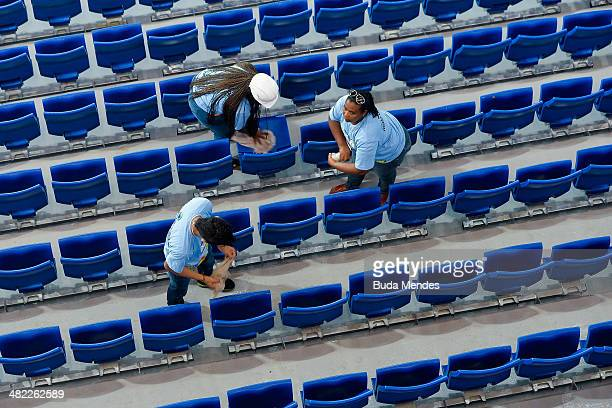 Workers prepare the stadium before the match between Santos and Mixto as part of the Brazil Cup 2014 at Arena Pantanal on April 2 2014 in Cuiaba...