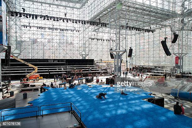 Workers prepare the stage for Democratic presidential candidate Hillary Clinton's election night event at the Jacob K. Javits Convention Center,...