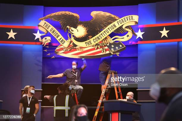 Workers prepare the stage for the first presidential debate between U.S. President Donald Trump and Democratic presidential nominee Joe Biden at Case...