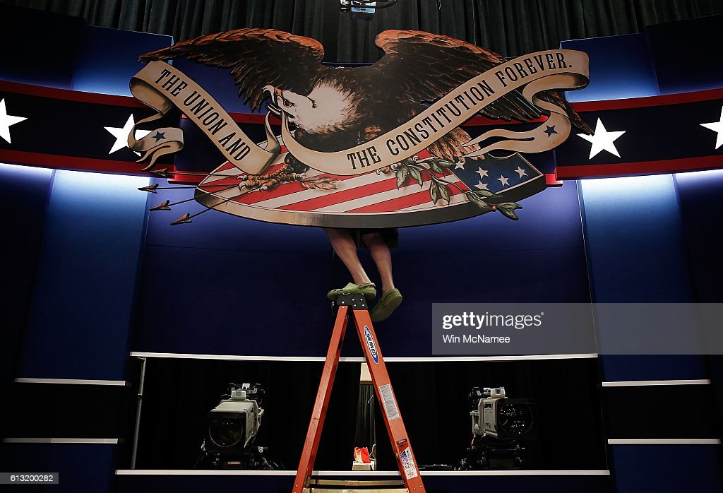 Workers prepare the stage for the second presidential debate at Washington University October 7, 2016 in St. Louis, Missouri. The second presidential debate between Republican presidential candidate Donald Trump and Democratic presidential candidate Hillary Clinton is scheduled to take place October 9.
