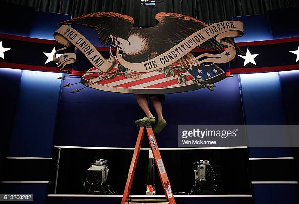 Workers prepare the stage for the second presidential debate at Washington University October 7 2016 in St Louis Missouri The second presidential...
