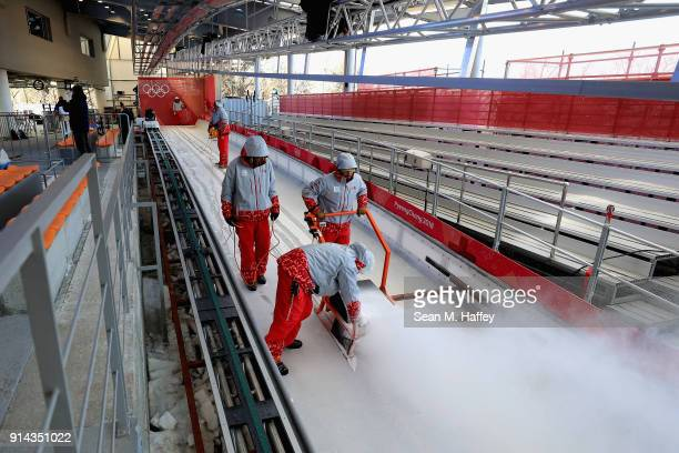 Workers prepare the track at the Olympic Sliding Centre ahead of the PyeongChang 2018 Winter Olympic Games on February 5 2018 in Pyeongchanggun South...
