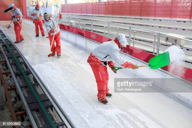 Workers prepare the track at the Olympic Sliding Centre during previews ahead of the PyeongChang 2018 Winter Olympic Games on February 5 2018 in...