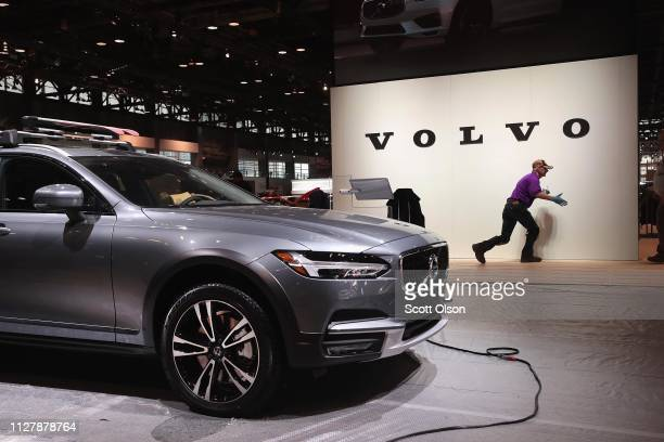 Workers prepare the Volvo display before the opening of the Chicago Auto Show at McCormick Place on February 06 2019 in Chicago Illinois The show...