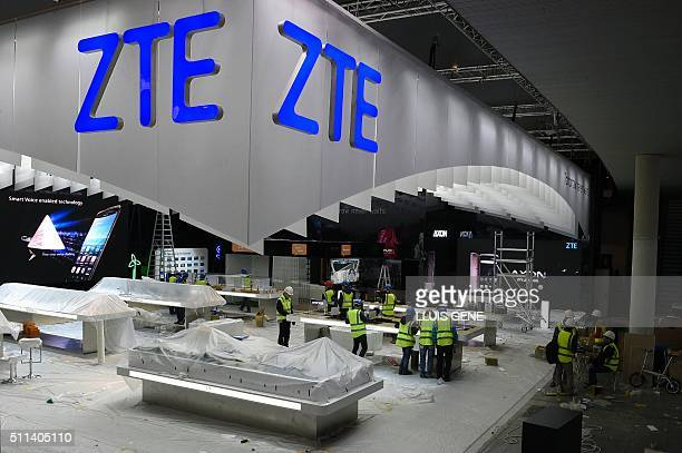 Workers prepare the ZTE Chinese company stand for the Mobile World Congress in Barcelona on February 20 before the start of the world's biggest...