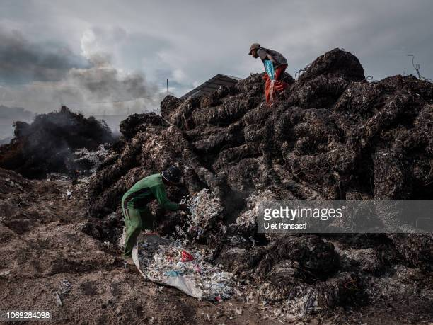 Workers prepare to burn plastic waste at a import plastic waste dump in Mojokerto on December 4, 2018 in Mojokerto, East Java, Indonesia. Indonesia's...