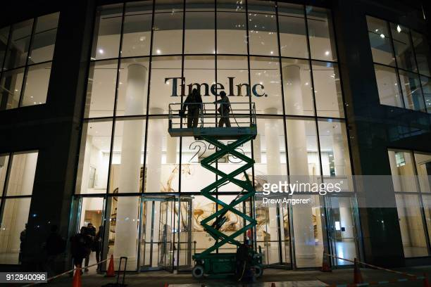 Workers prepare to cover up the Time Inc. Signage with Meredith Corporation signage at the Time Inc. Office building in Lower Manhattan, January 31,...