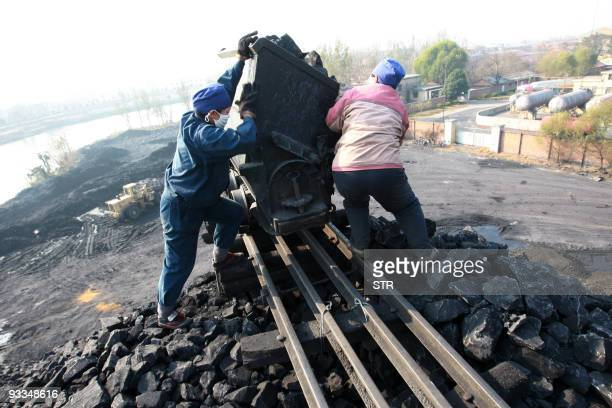 Workers prepare to pile up the coal for processing at a mine yard in Huaibei central China's Anhui province on November 24 2009 More deadly accidents...