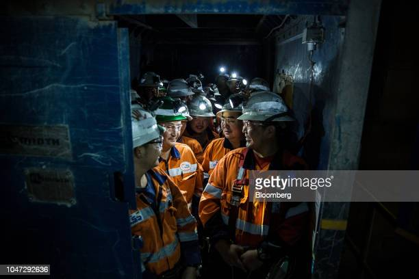 Workers prepare to ride an elevator down to the underground mining project at the Oyu Tolgoi coppergold mine jointly owned by Rio Tinto Group's...