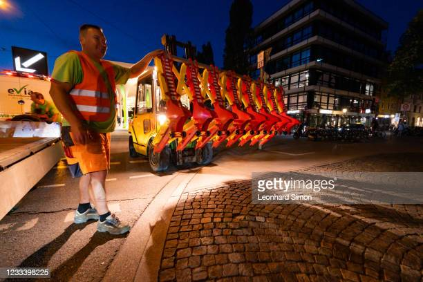 Workers prepare to set up a roadblock to prevent the formation of car parades during the EURO 2020 kick-off match between Turkey and Italy on June 11...