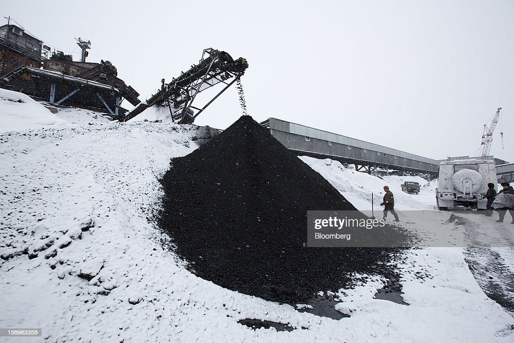 Workers prepare to take coal samples from a storage mound at the Sibirginsky open pit coal mine, owned by OAO Mechel and operated by Southern Kuzbass Coal Co., near Myski, in Kemerovo region of Siberia, Russia, on Friday, Nov. 23, 2012. OAO Mechel is Russia's biggest maker of steelmaking coal. Photographer: Andrey Rudakov/Bloomberg via Getty Images