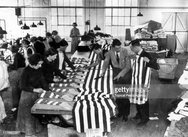 Workers preparing football shirts for Sunderland AFC and socks for Preston North End FC at the Bukta factory in Manchester Lancashire England United...