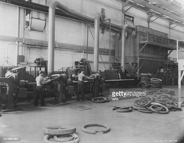 Workers preparing motor car tyres on a production line in a factory USA circa 1925