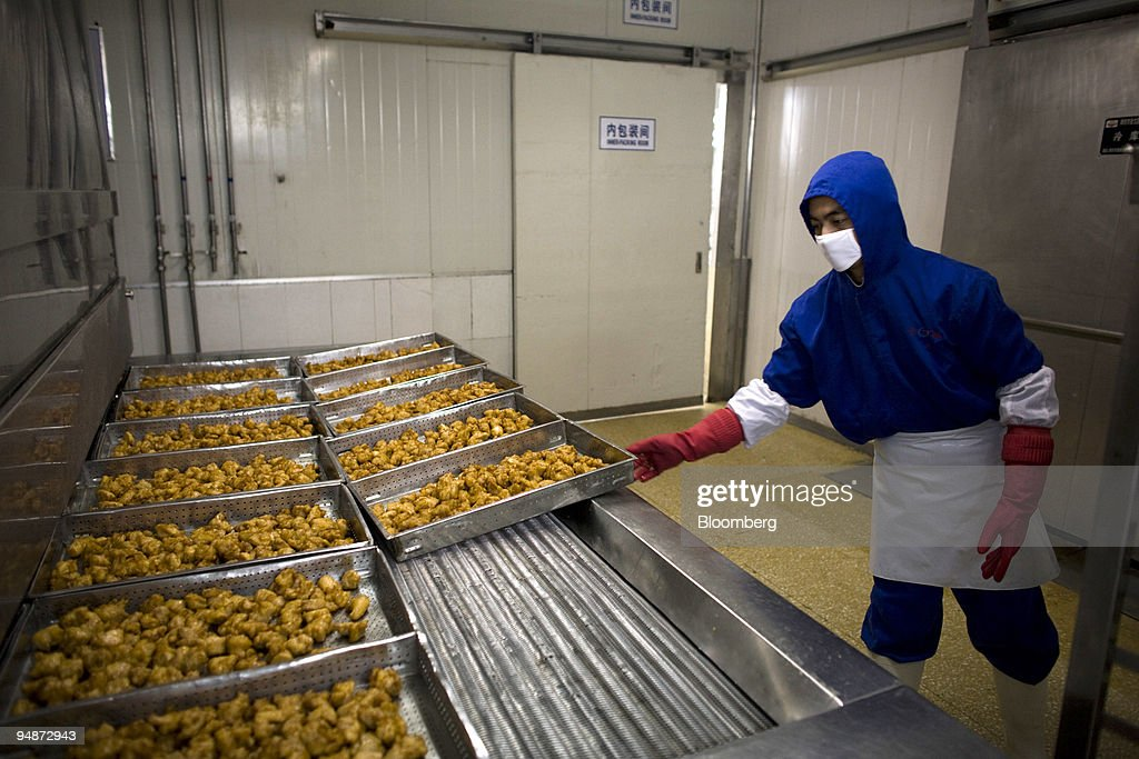 workers process food at a tyson foods inc meat processing plant in
