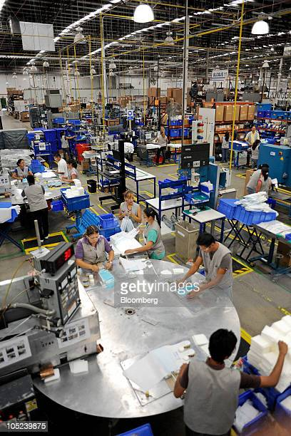 Workers produce and package medical accessories at the DJO Global plant in Tijuana Mexico on Monday Oct 11 2010 Production at Mexican export...