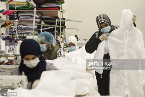 Workers produce protective clothing at a textile factory in the southern Lebanese city of Sidon on March 14 2020 Schools universities coffee shops...