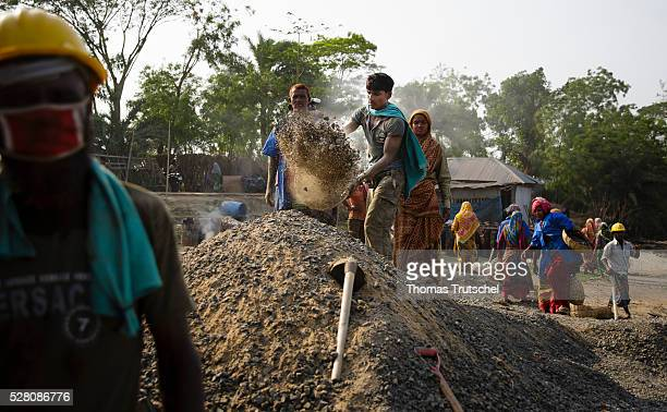 Workers produce tarmac for the road construction on April 11 2016 in Khulna Bangladesh
