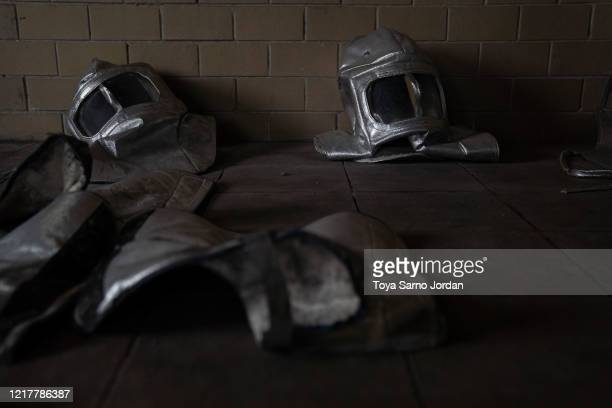Workers' protective gear wait to be disinfected at a crematorium at Panteon Municipal on June 05 2020 in Ciudad Nezahualcoyotl Mexico Despite the...