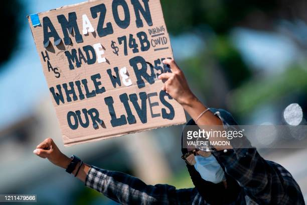 TOPSHOT Workers protest against the failure from their employers to provide adequate protections in the workplace of the Amazon delivery hub on...