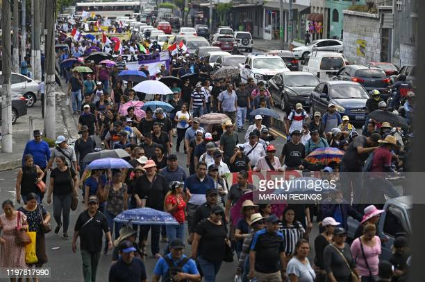 Workers protest against the Pension Fund Administrator in San Salvador on January 31, 2020. - Thousands of Salvadorans marched on Friday in the...
