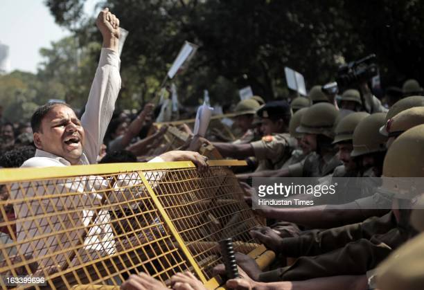 BJP workers protest in front of Delhi Chief Minister Sheila Dikshit residence demanding restoration of water supply in Brijvasan area on March 9 2013...