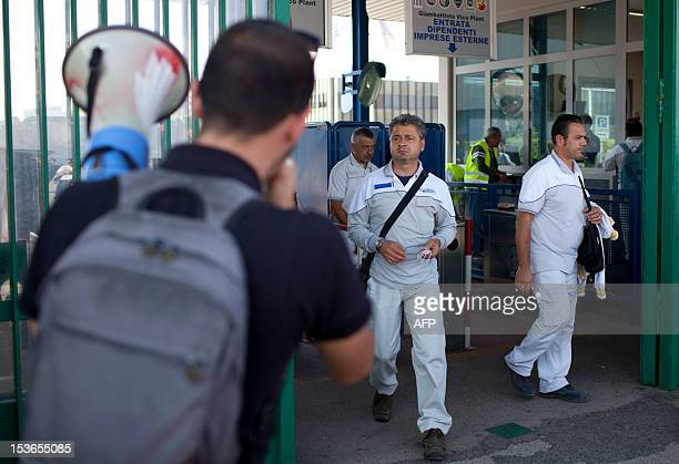 Workers protest on October 8, 2012 against their temporary dismissal in Pomigliano D'Arco, near Naples. Fiat agreed in July to move production of its...