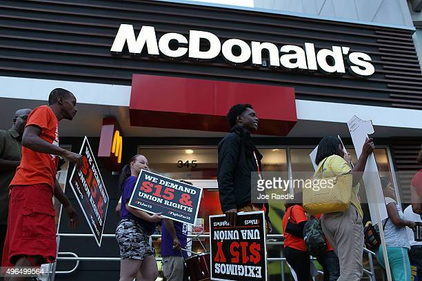 Workers protest outside a McDonald's restaurant on November 10 2015 in Miami Florida The protesters are demanding action from state legislators and...