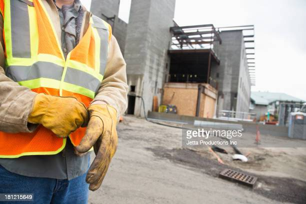 Workers pulling on gloves on site