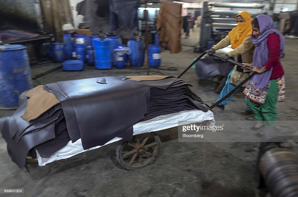 Workers push a cart carrying sheets of dyed leather at the Jalandhar Leather Pvt tannery in Jalandhar Punjab India on Saturday Jan 21 2017 India`s 51.