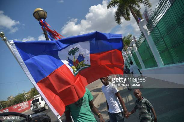 Workers put flags around the walls of the National Palace in the Haitian capital PortauPrince on February 6 one day before of the Inauguration...